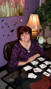 deborah leigh at her desk with cards laid out in front of her